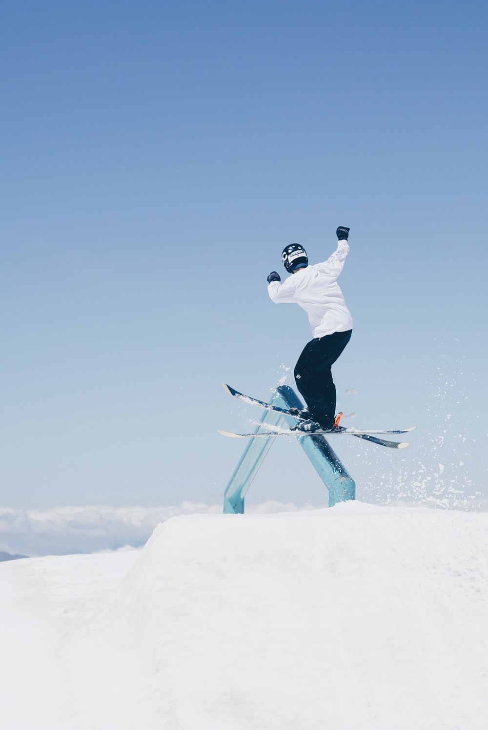 man doing tricks on skis