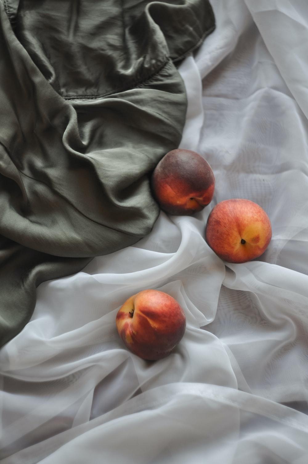 three peach fruits