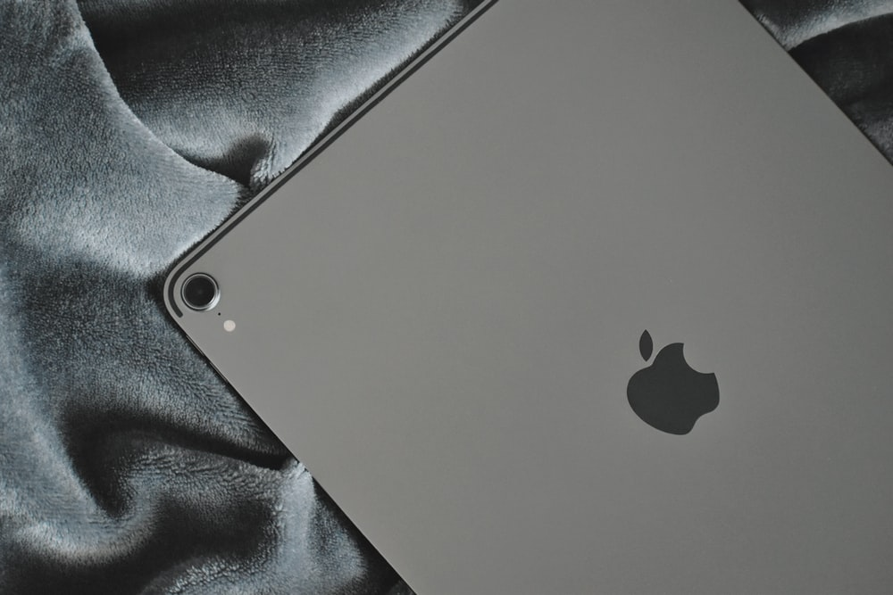 silver Apple iPad on grey textile
