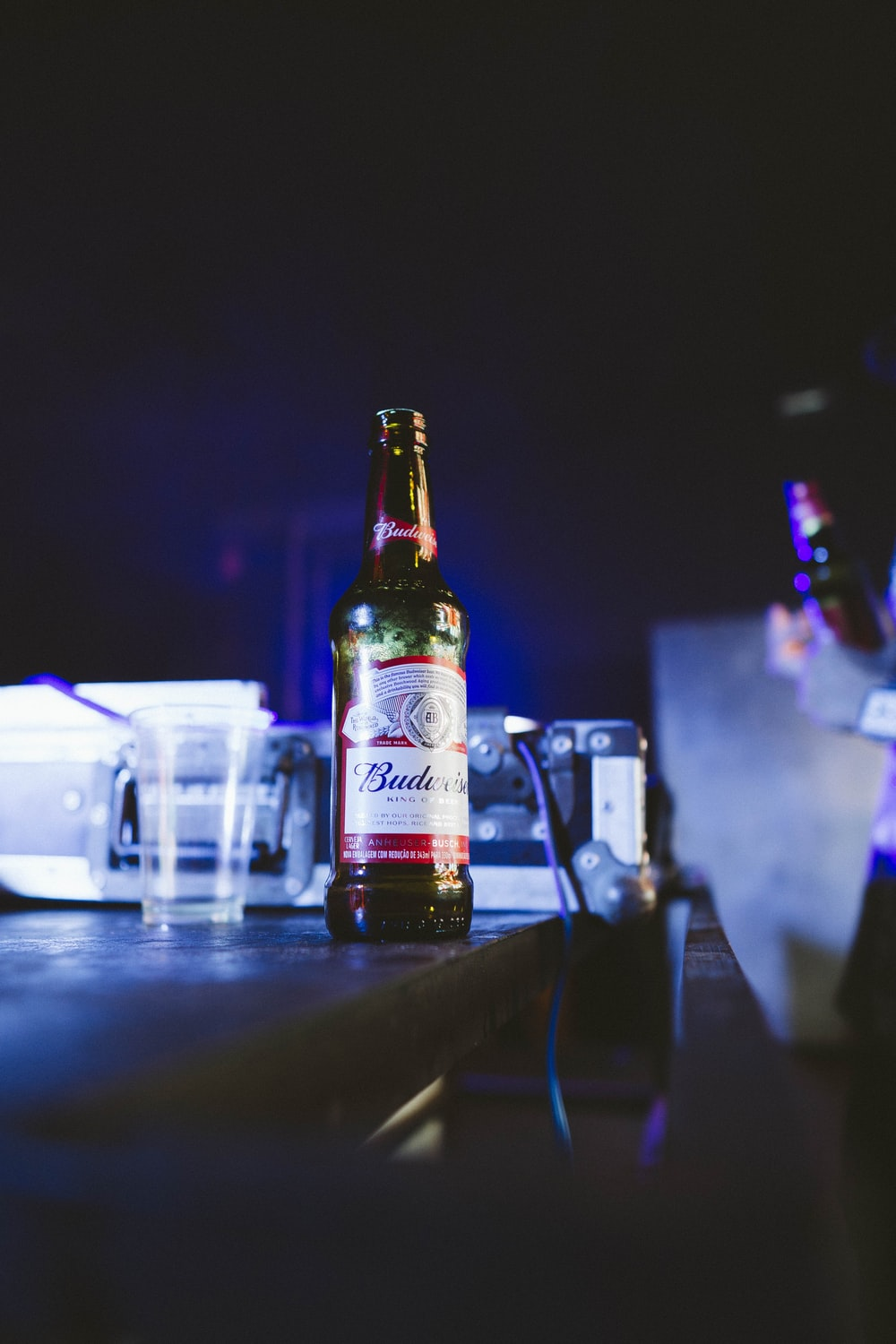 Budweiser bottle on brown wooden table
