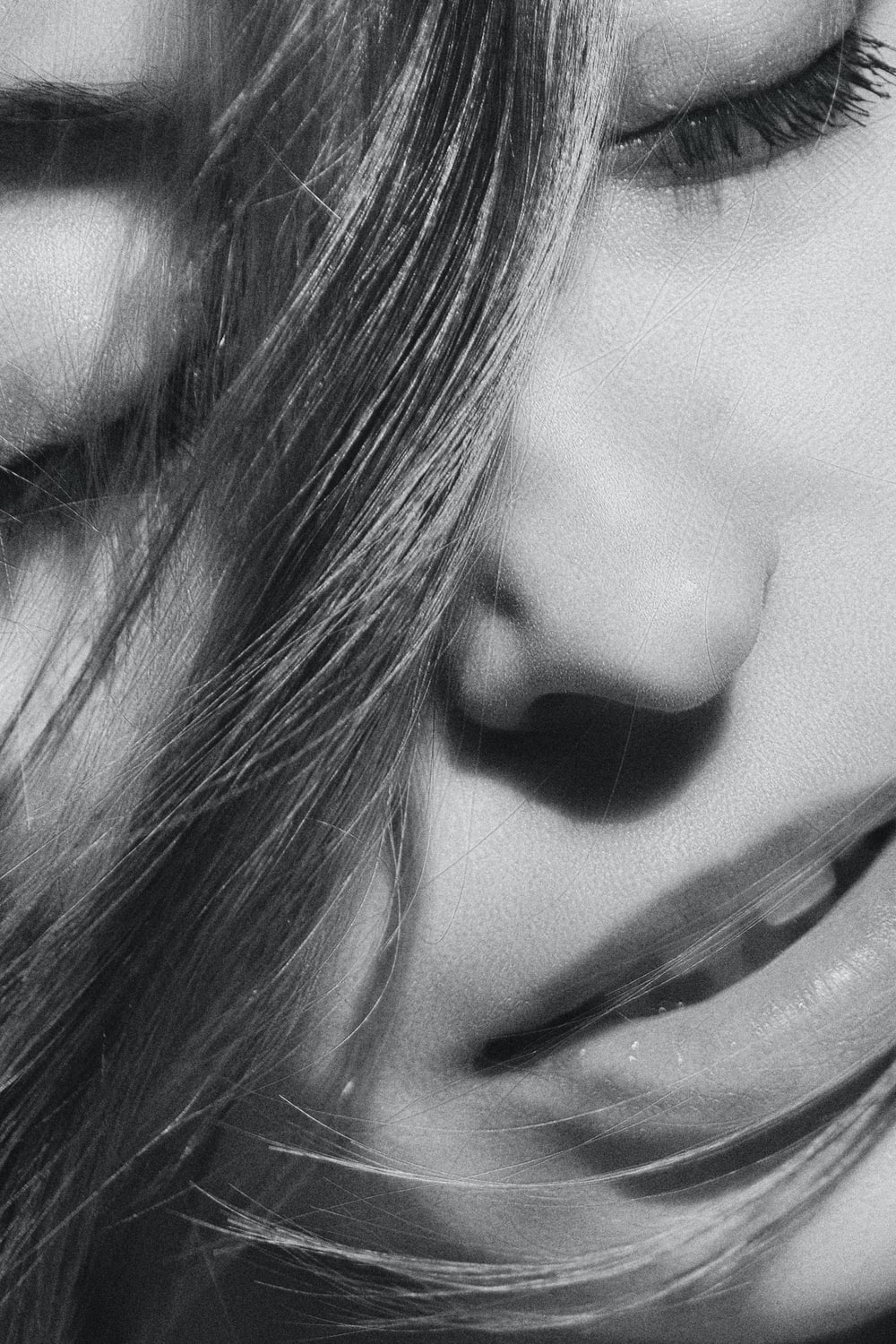 grayscale photo off woman's face