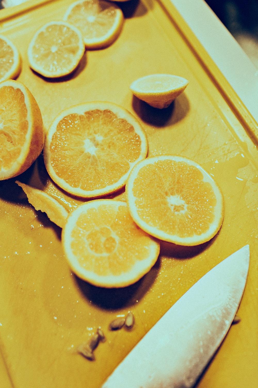 sliced lemon near gray stainless steel knife