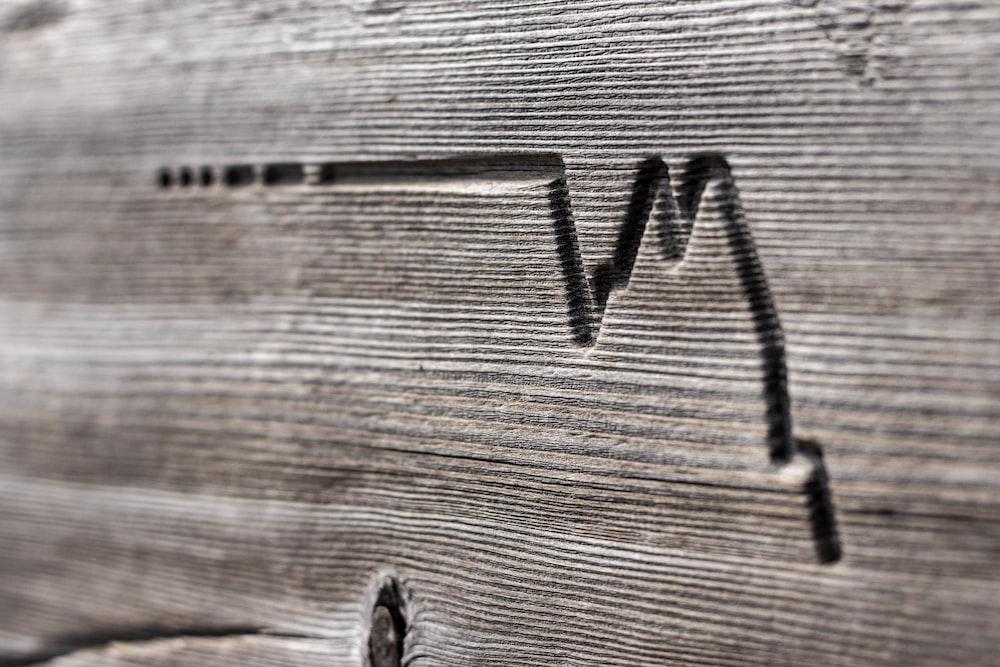 wave engraved on grey wood