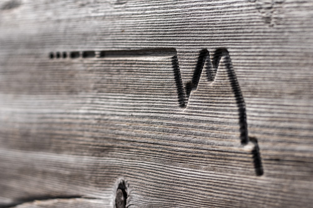 wave engraved on grey wood