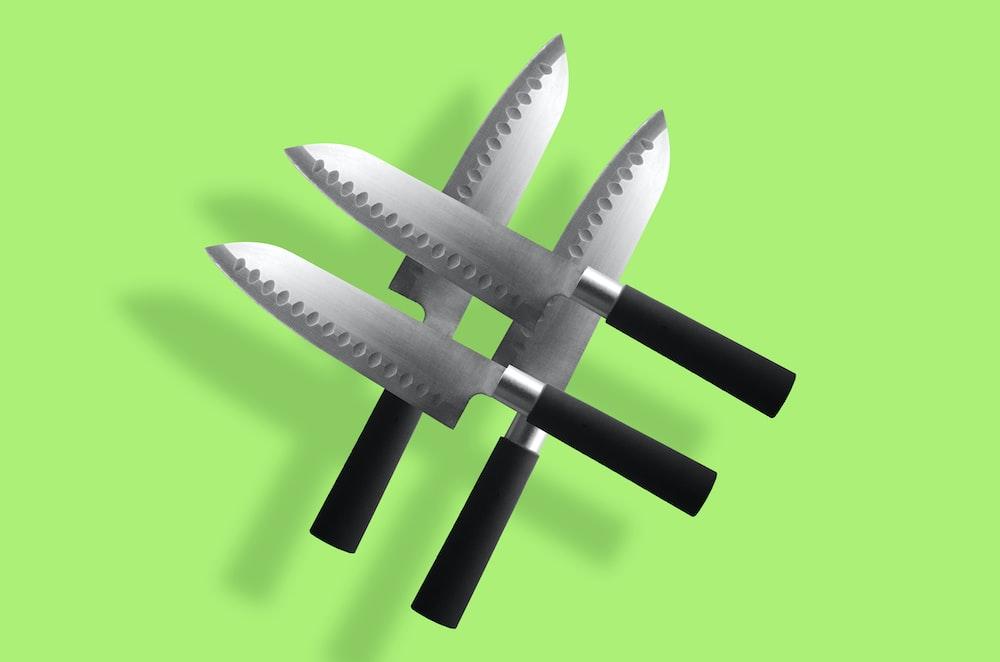 four black kitchen knives