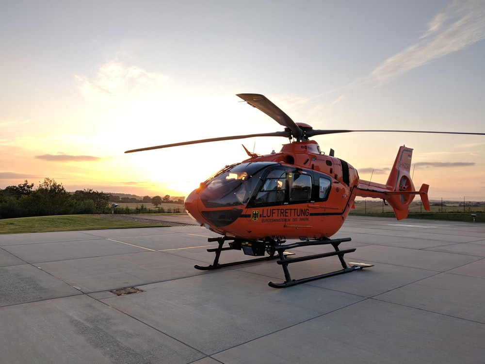 closeup photo of orange and black helicopter