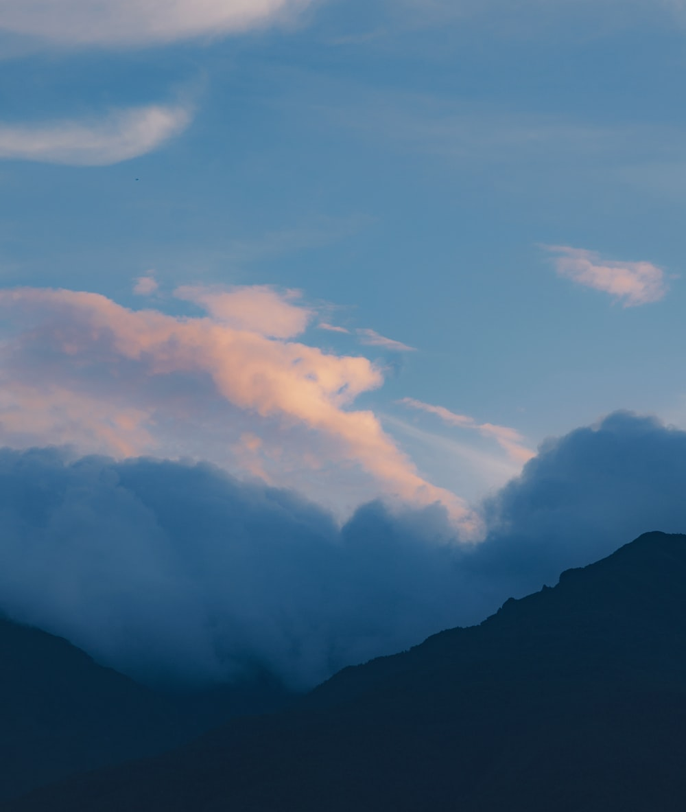 mountain under white clouds during daytime