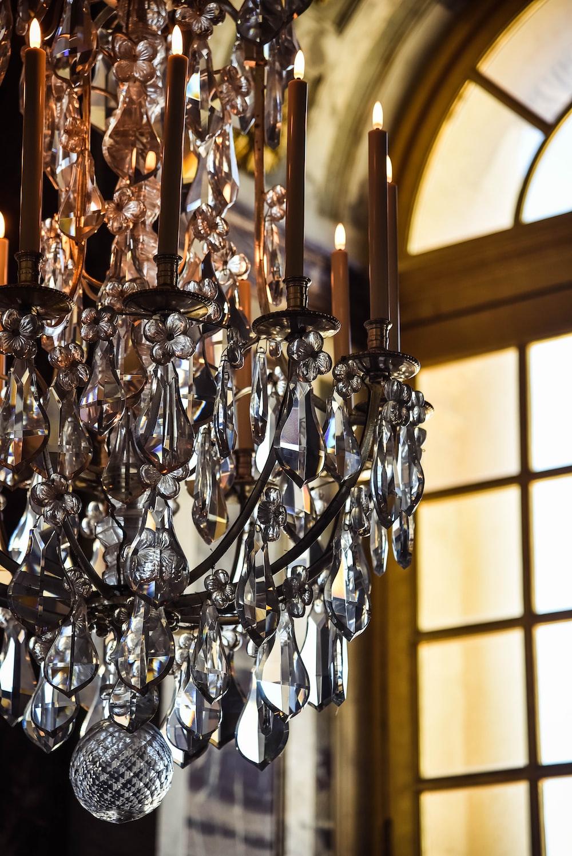 gold clear crystals chandelier near window