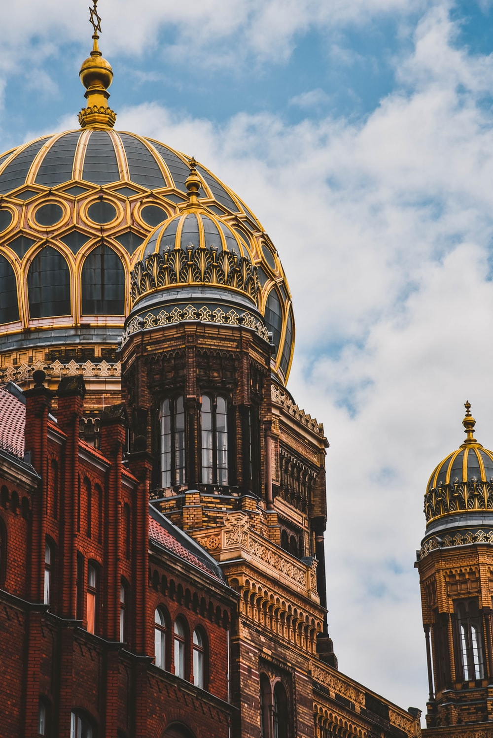 yellow and black domed building during daytime
