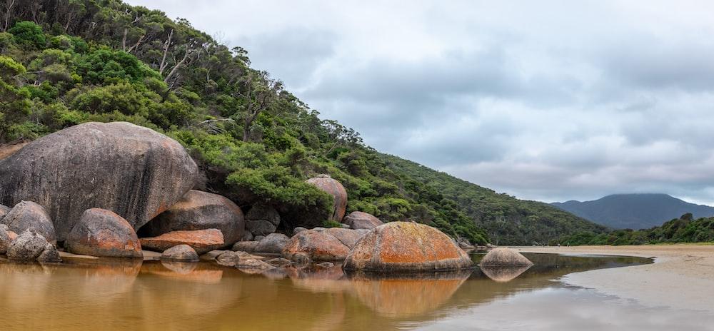 boulders facing body of water