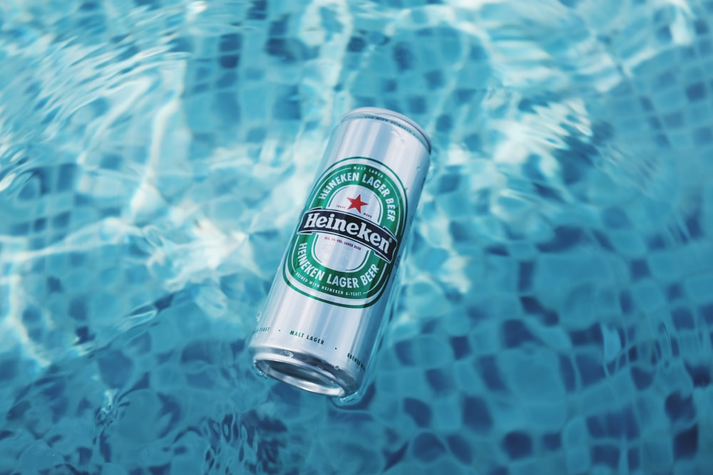 Heineken drink can floating on water