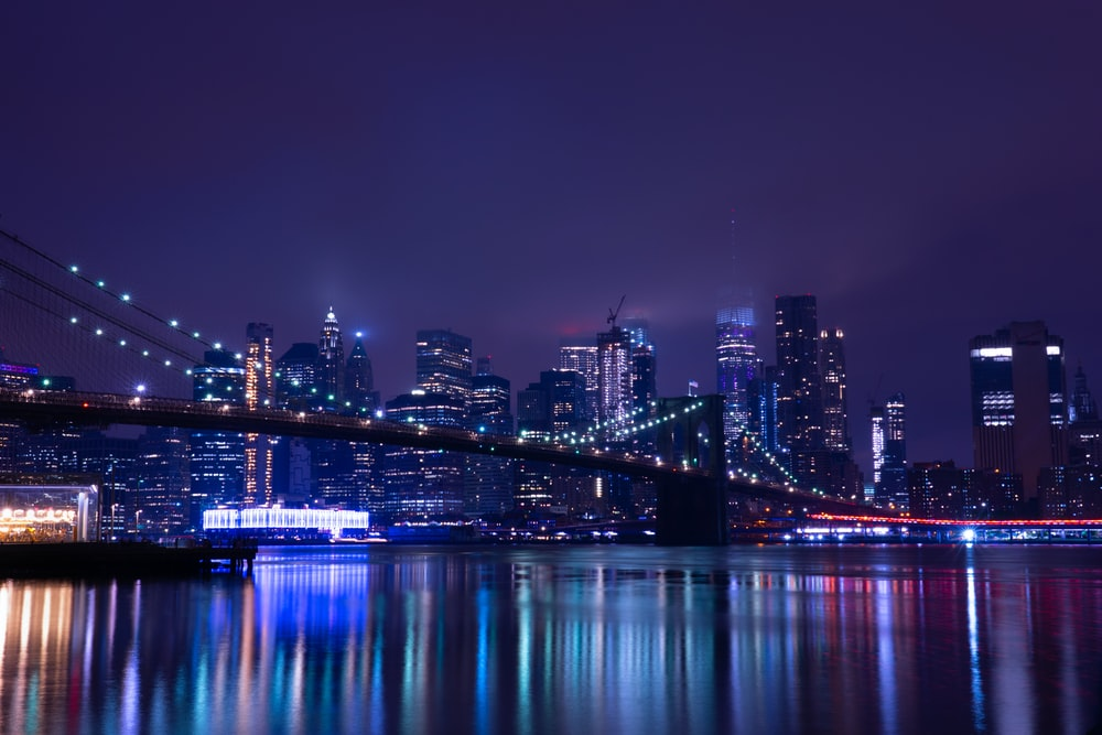 body of water across city buildings during nighttime