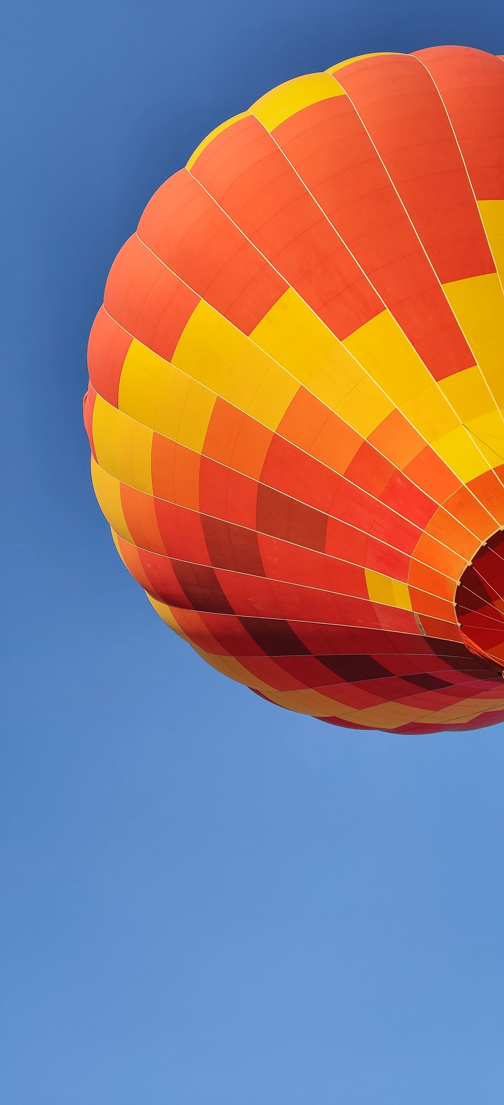 red and yellow hot air ballooning during daytime