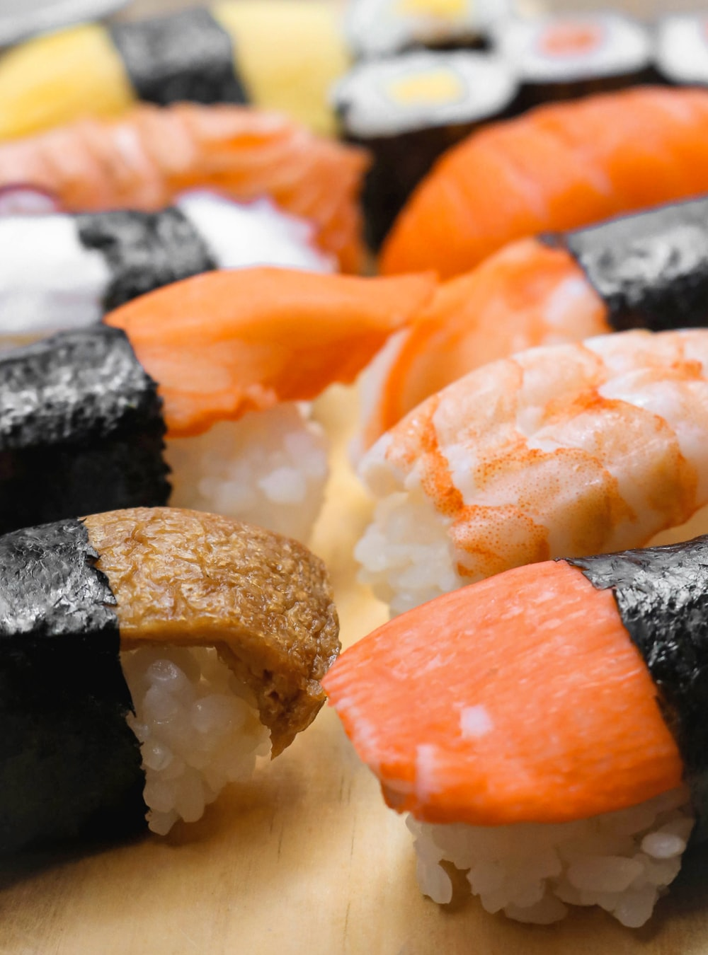 sushi's on brown surface