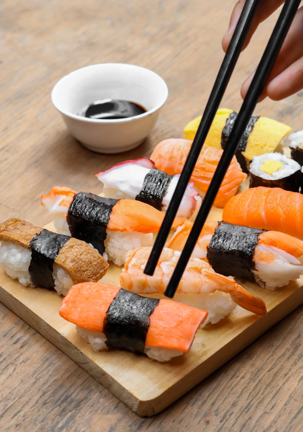 sushi on wooden tray