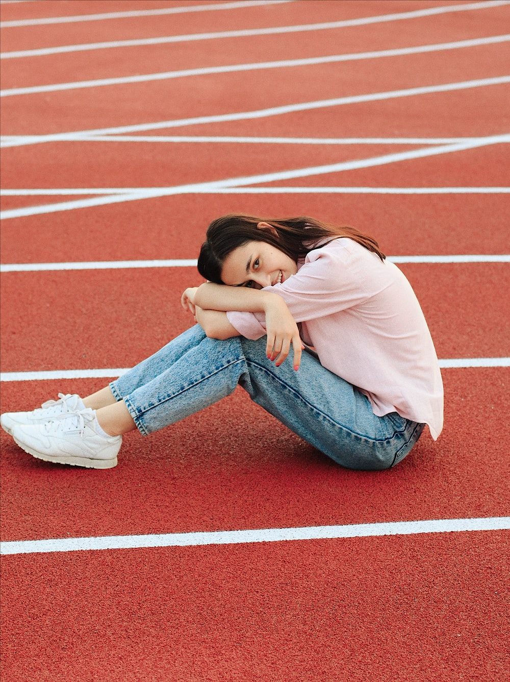 woman sitting on track field