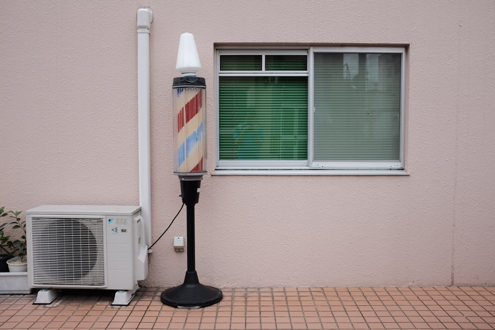barber's lamp beside air condenser