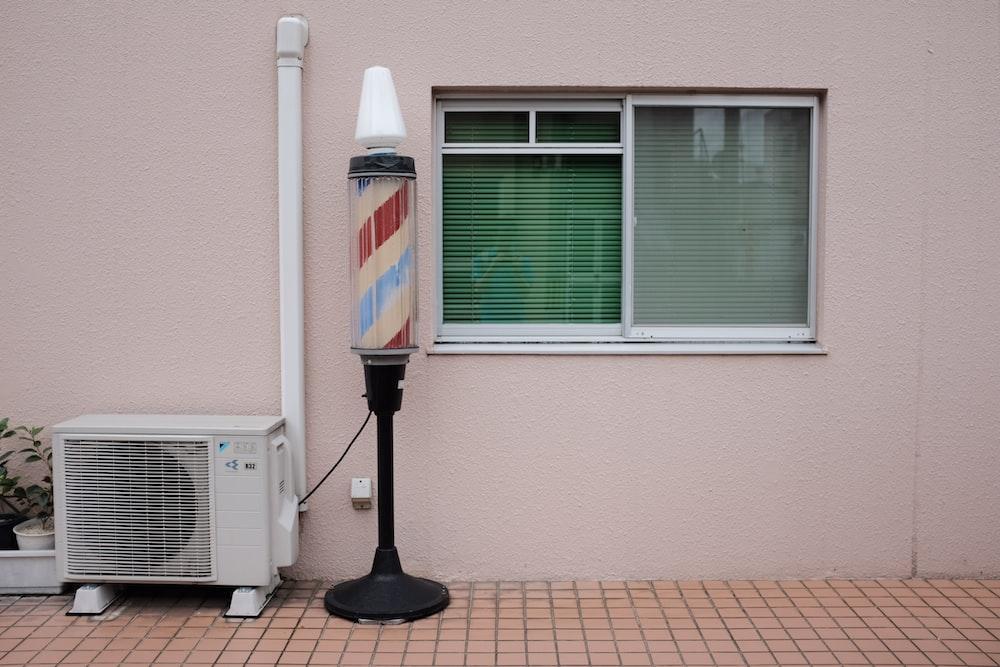 barber's lamp beside air condenser