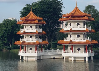 white-and-brown concrete temples on water
