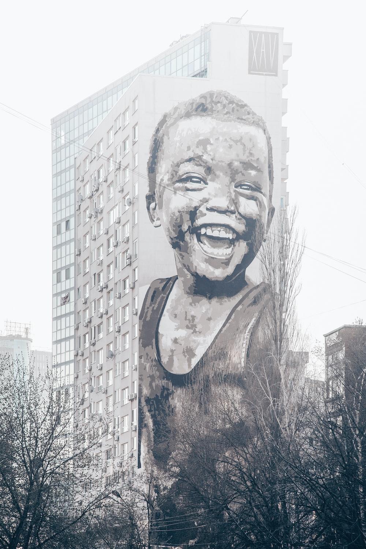 child laughing graffiti art on wall