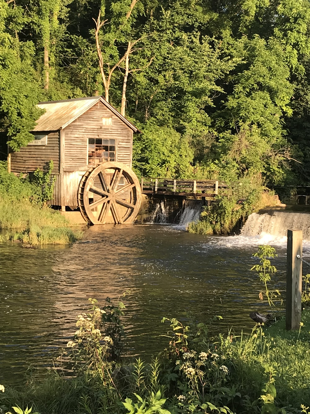 wooden water wheel on river