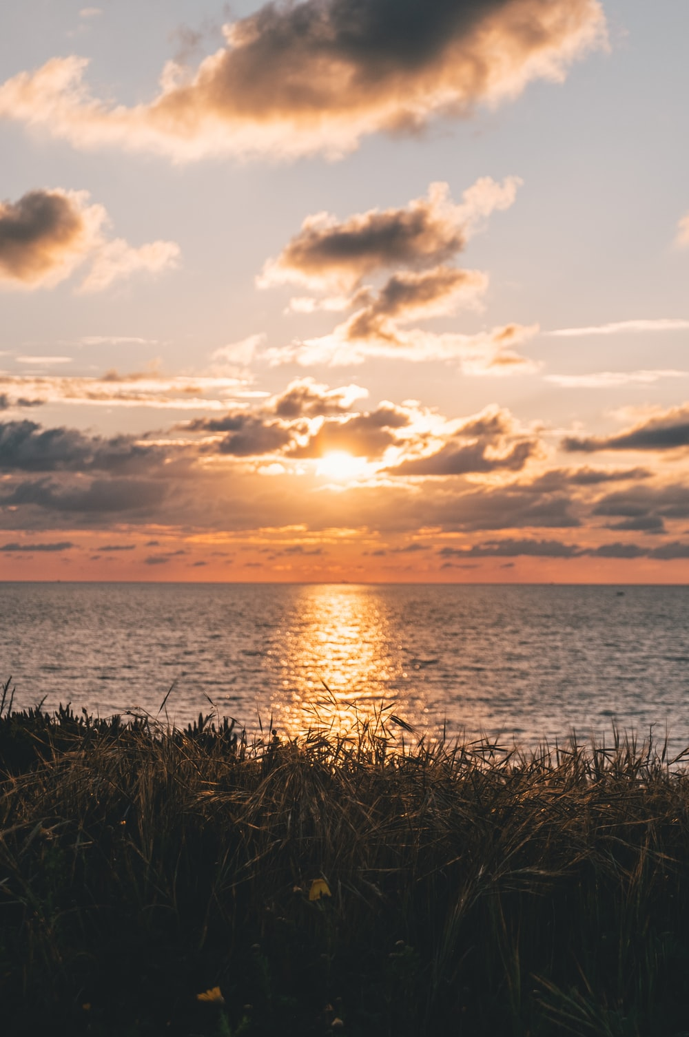 orange setting sun over sea