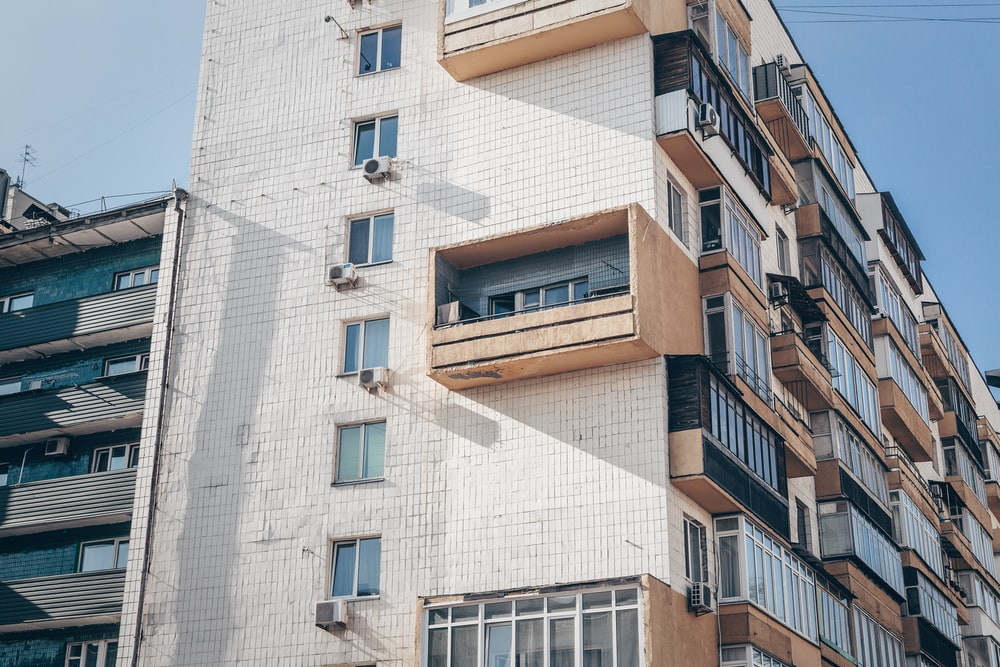 low angle photography of brown high rise building