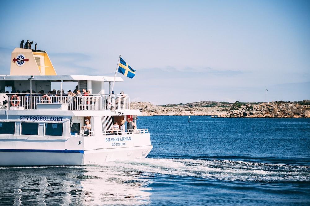 white passenger boat on sea