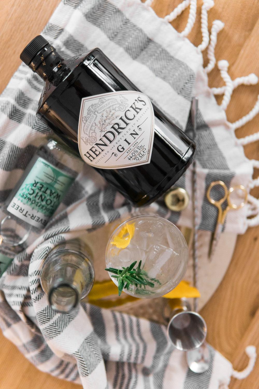 Hendrick's Gin bottle on grey textile