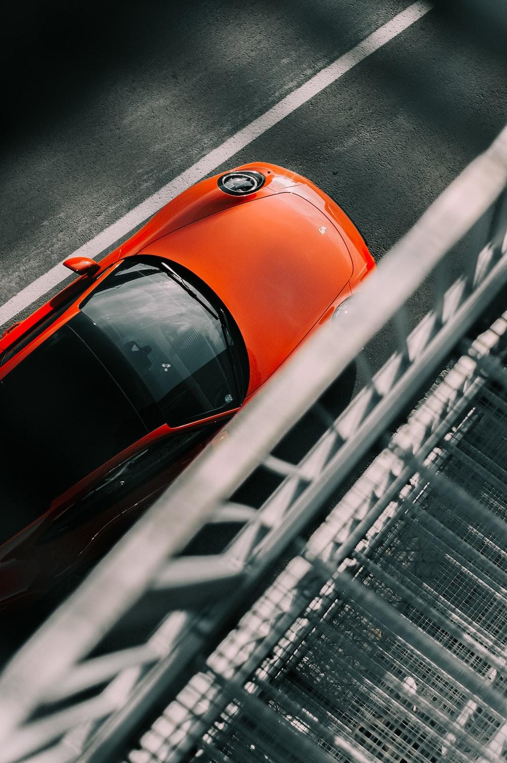 orange car on road