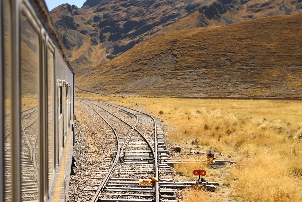 grey metal railway during daytime
