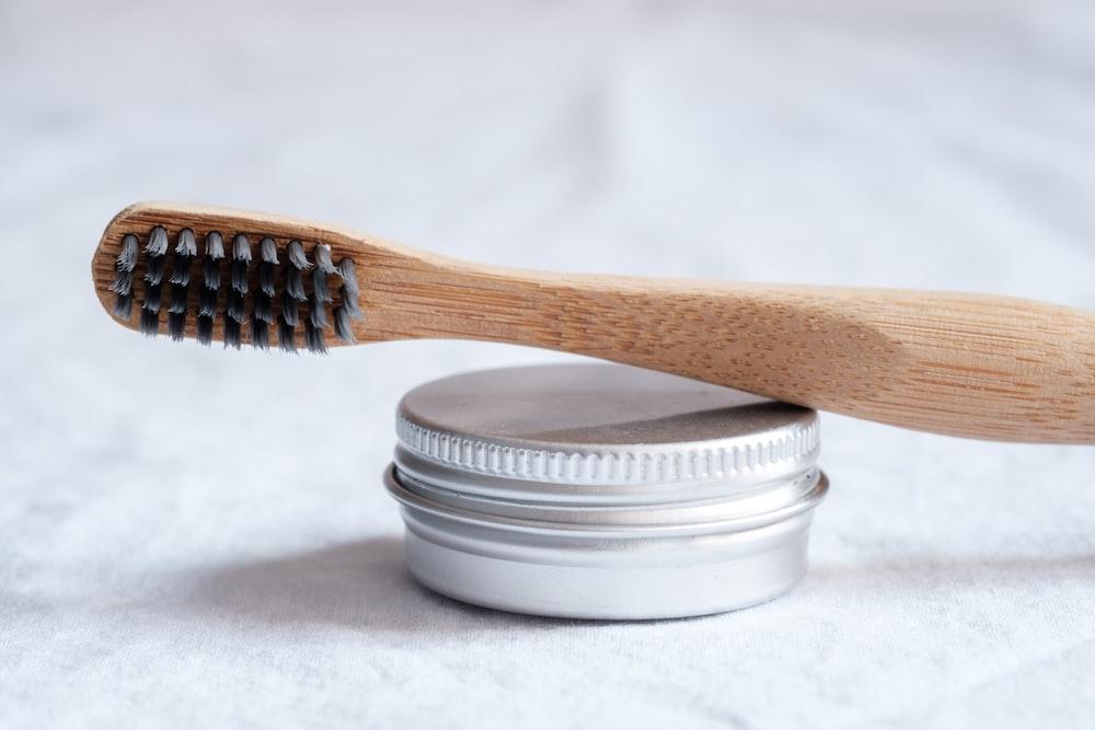 brown wooden toothbrush