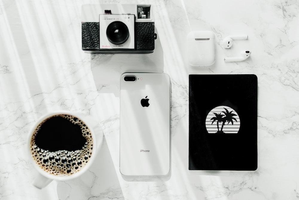 silver iPhone 7 Plus near camera