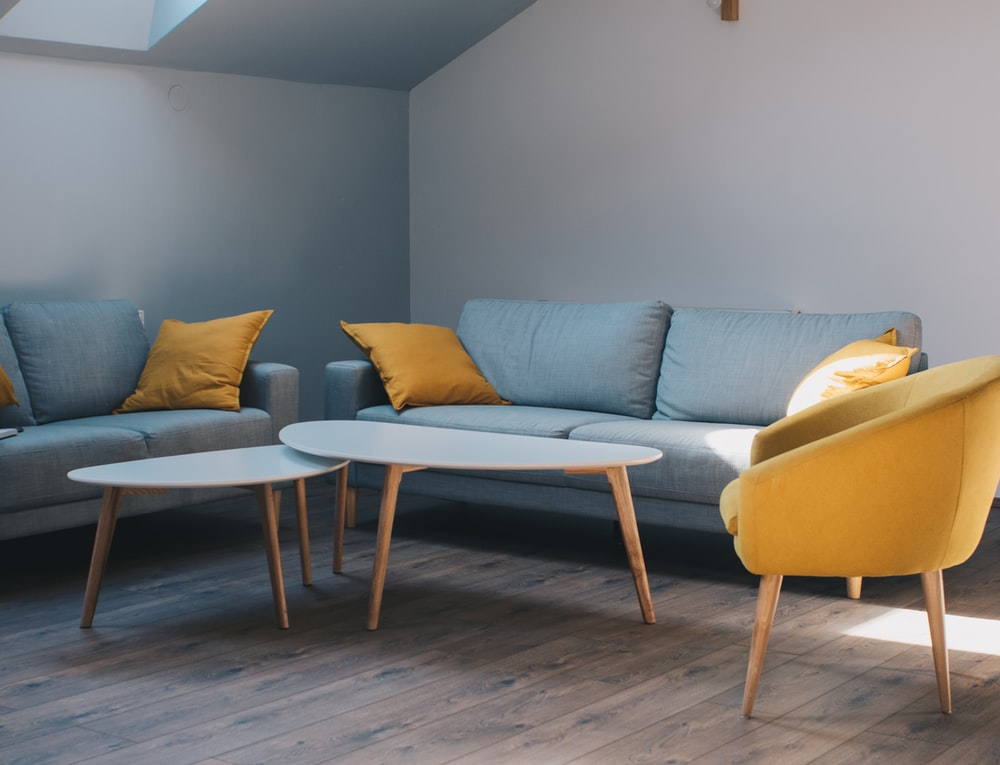 white coffee table and grey fabric sofa
