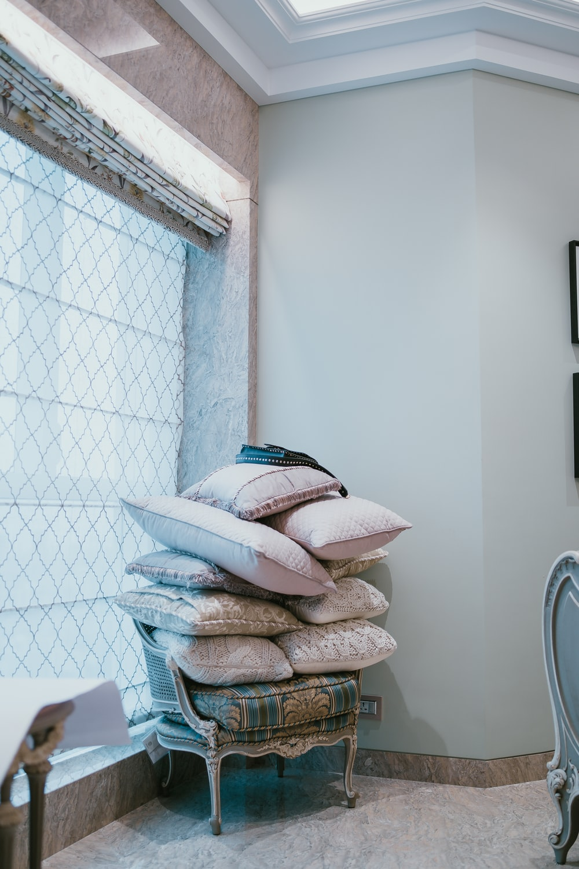 pillows on gray wooden armchair
