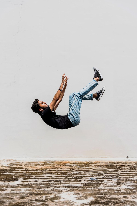 man in black T-shirt falling