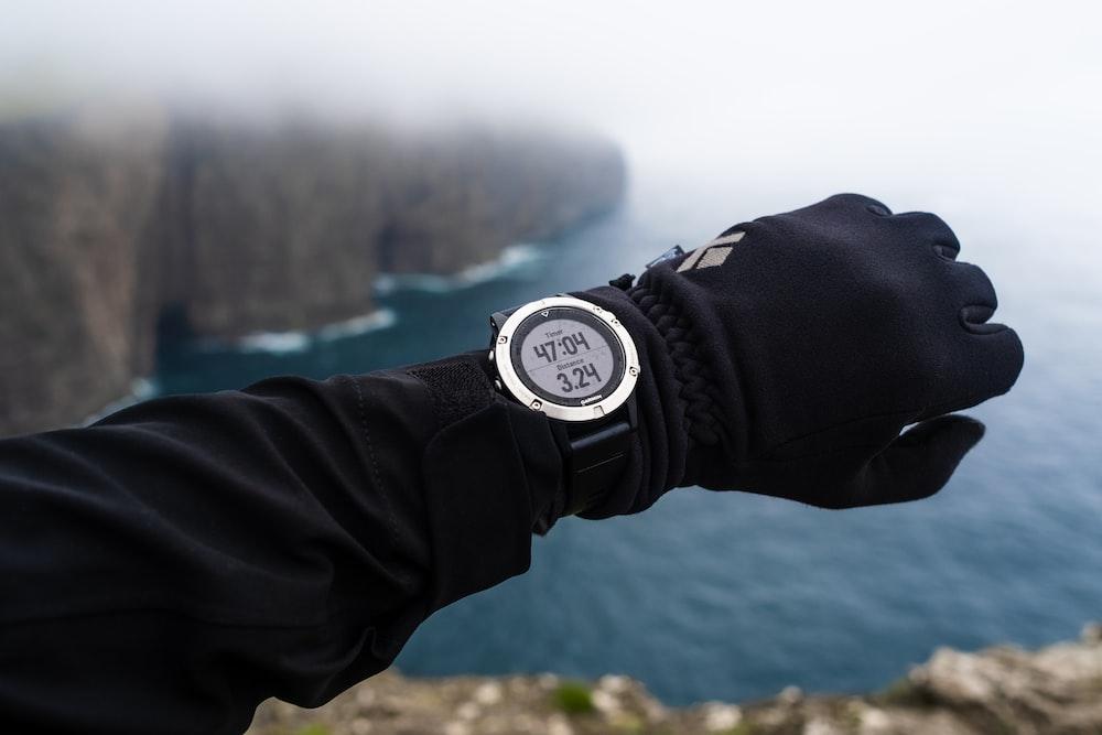 person wearing round digital watch