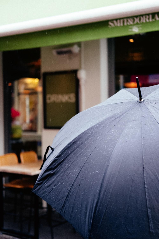 black umbrella in front of store