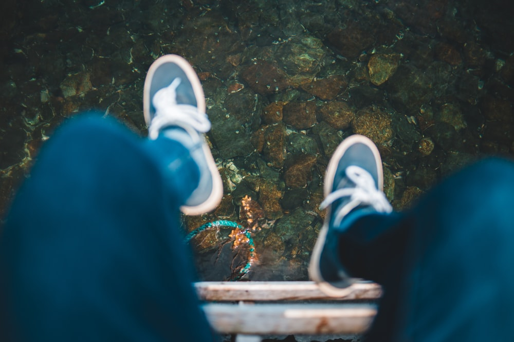 person sitting near water