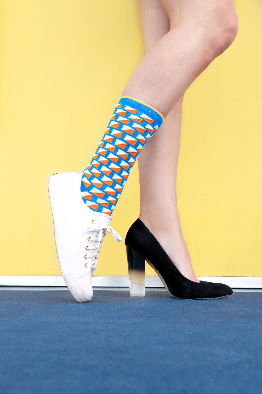 woman wearing sneaker and sandal