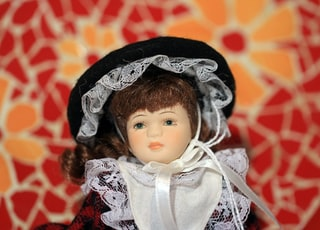 porcelain doll in white and black dress