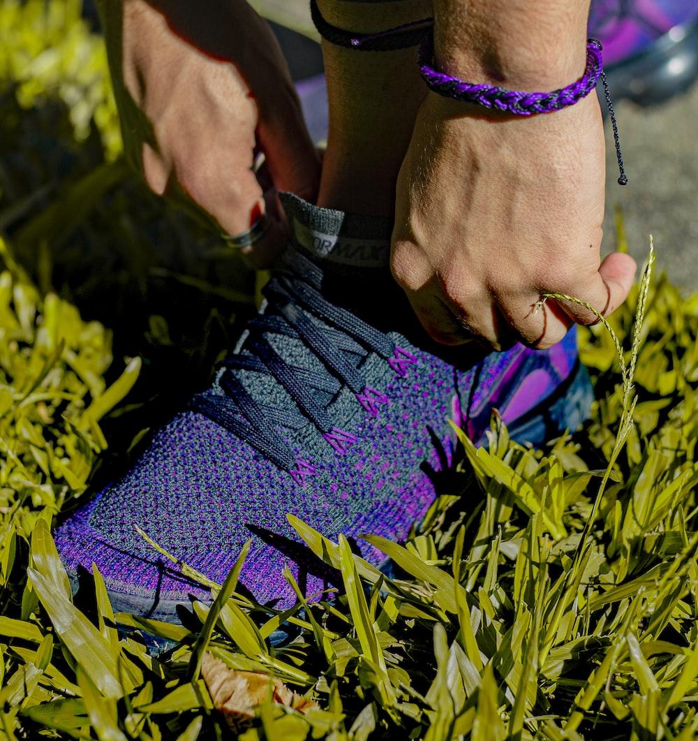 purple Nike athletic shoes