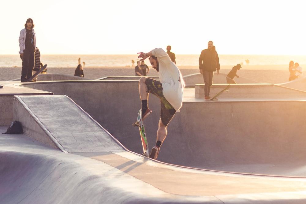 man playing skateboard during golden hour