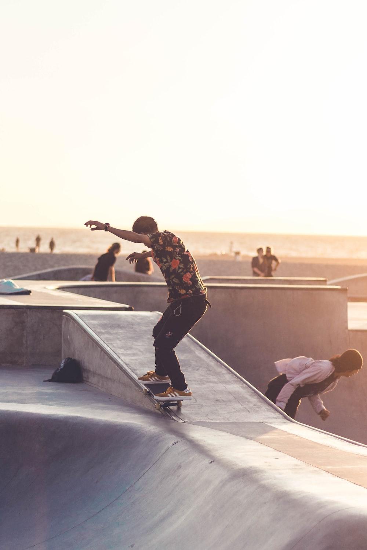 man riding black skateboard