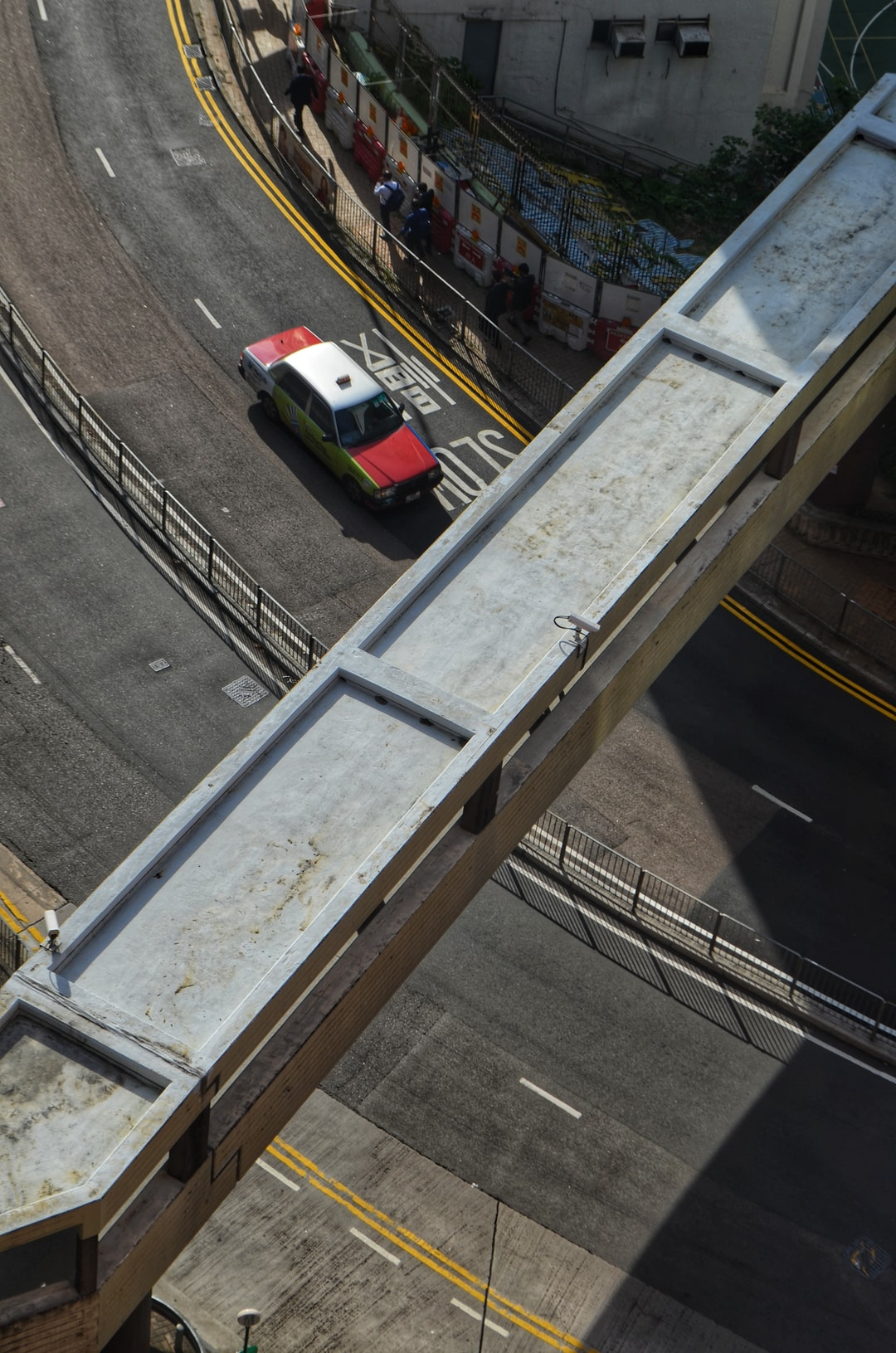 A taxi on a road in Mid-Levels, as seen from the University of Hong Kong
