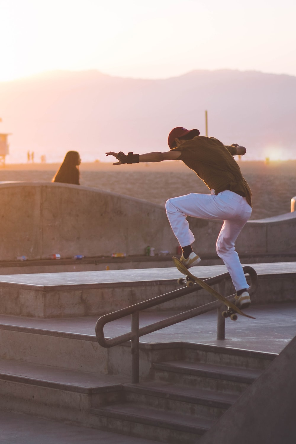 man playing skateboard during golden hour