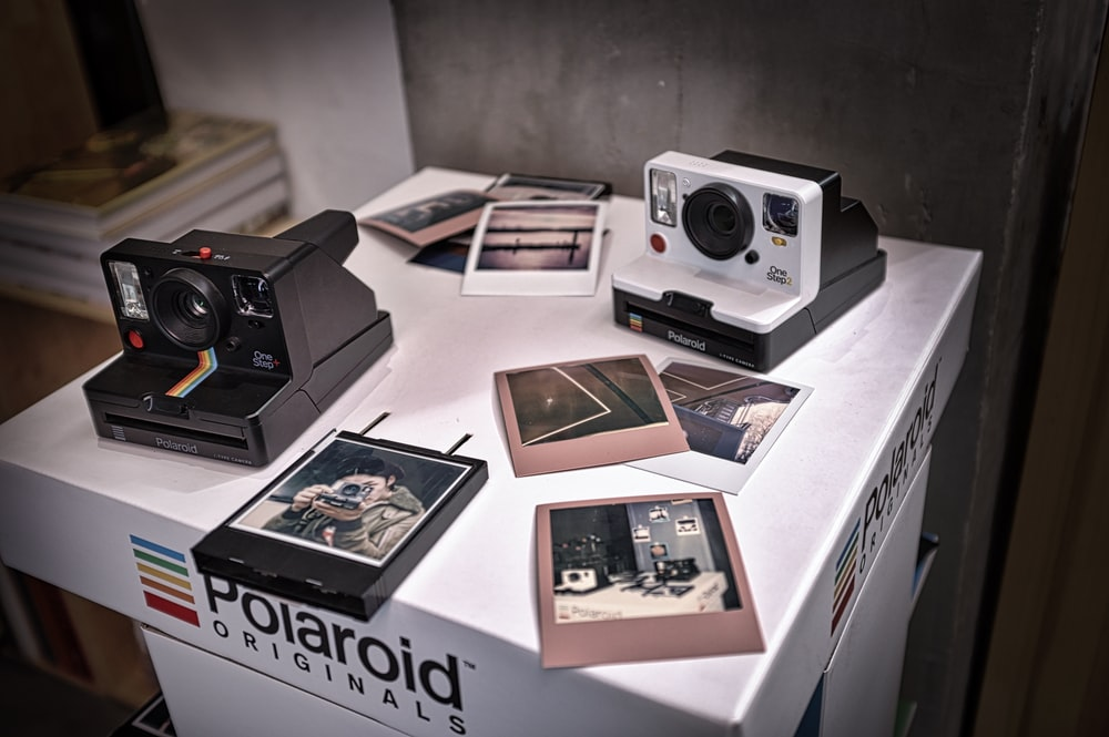 black and white Polaroid camera on box