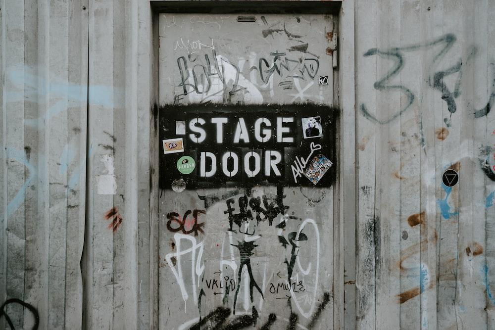 brown wooden door close-up photography