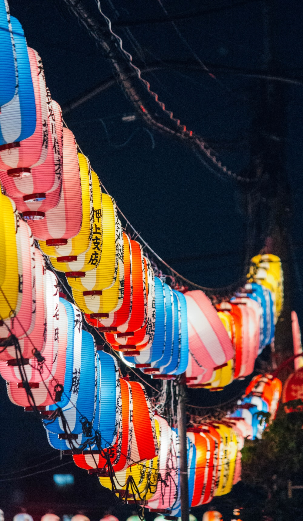 shallow focus photo of lighted lanterns