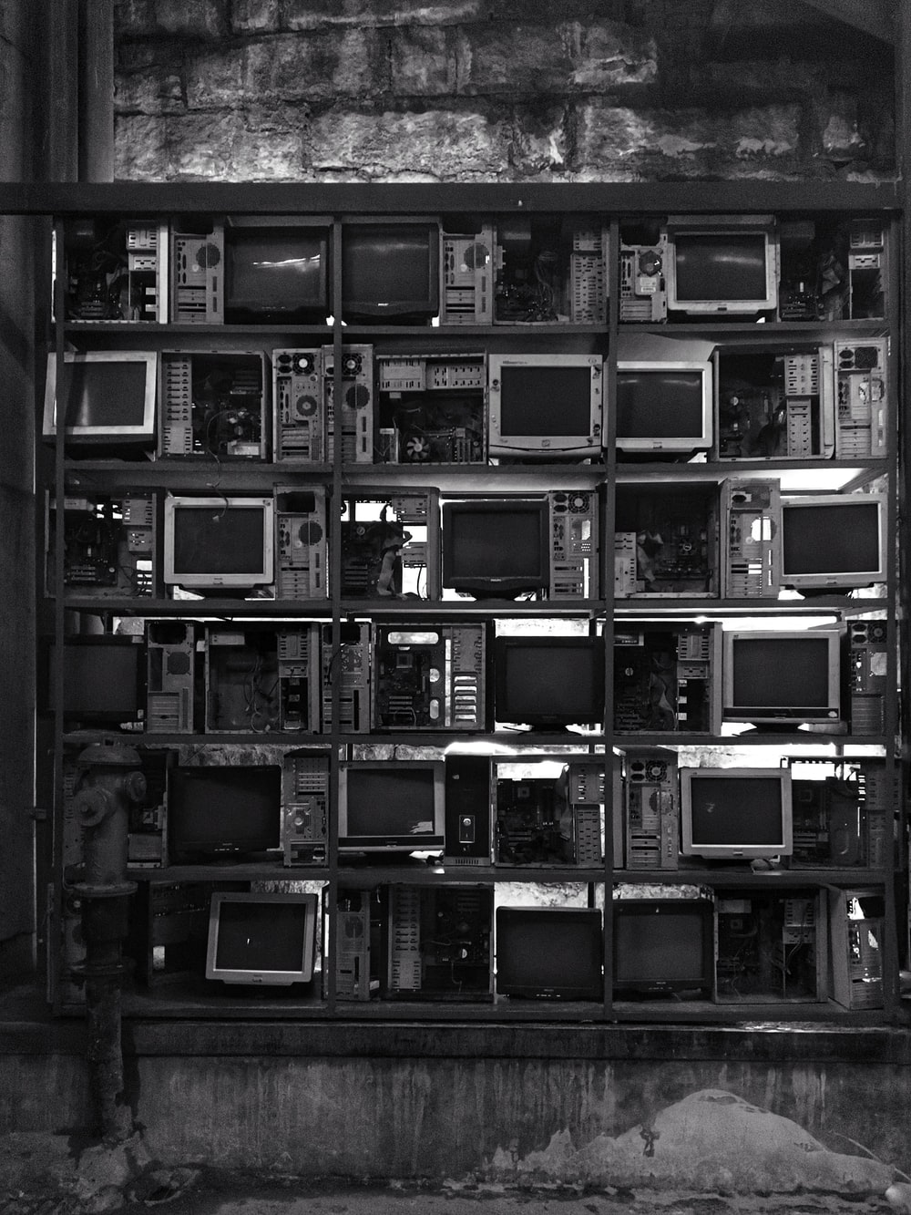 grayscale photography of CRT computer monitor lot